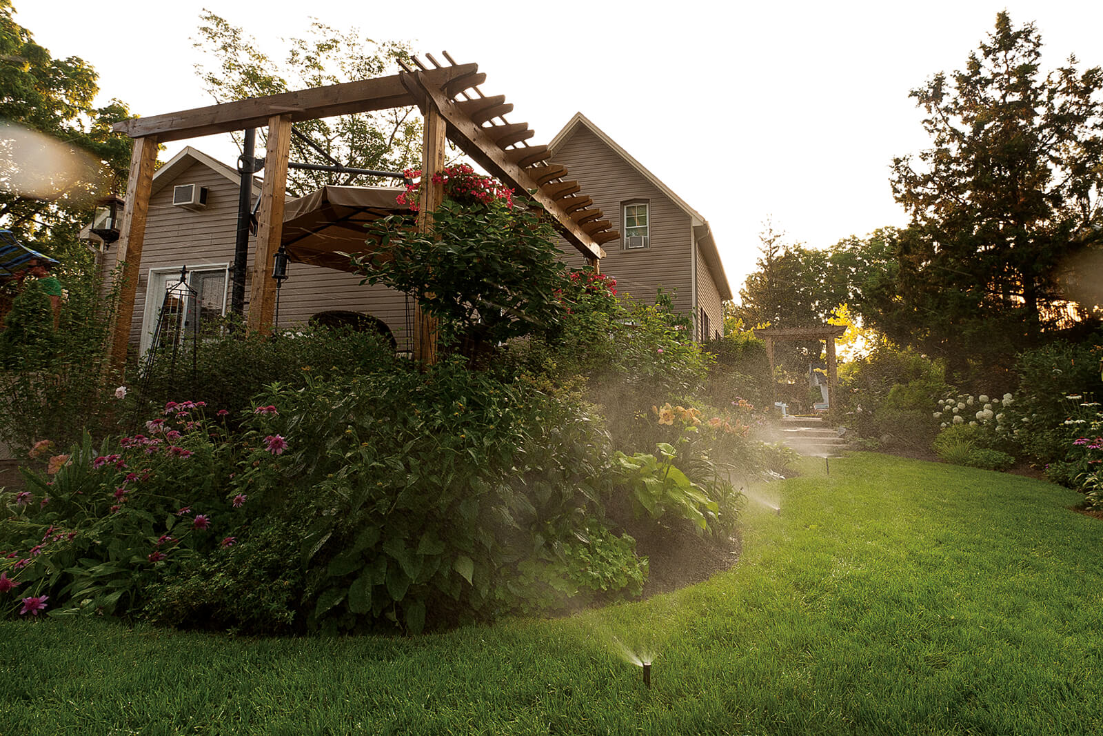 garden and lawn watered with in-ground irrigation system