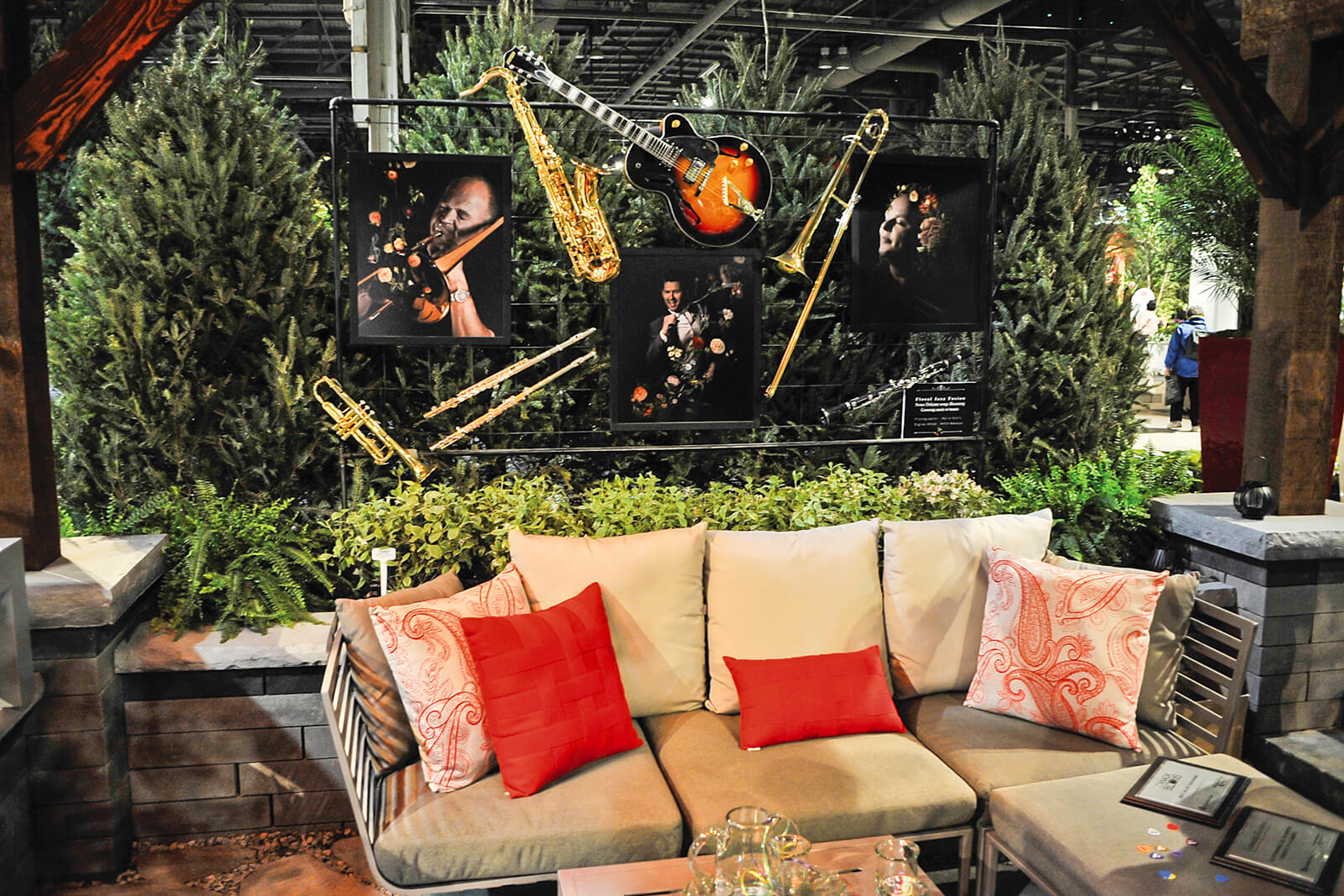 feature garden with couch and musical instruments suspended above