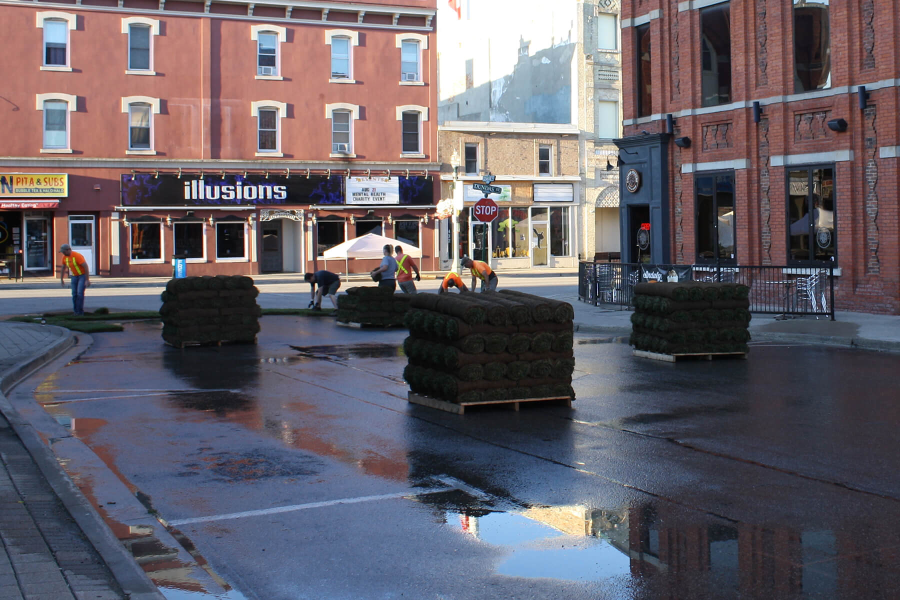 skids of sod on an empty street