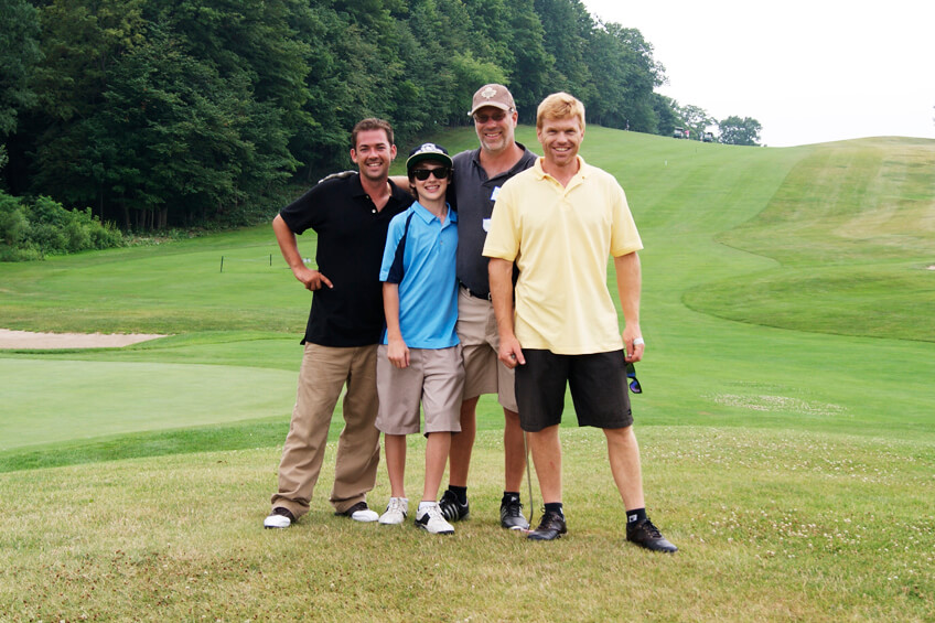 four men on a golf course