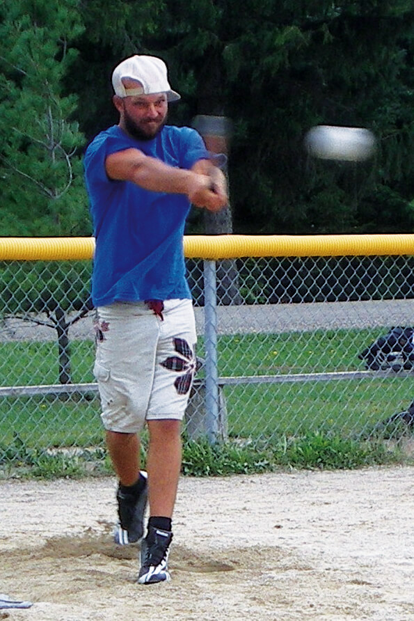 man hitting a baseball
