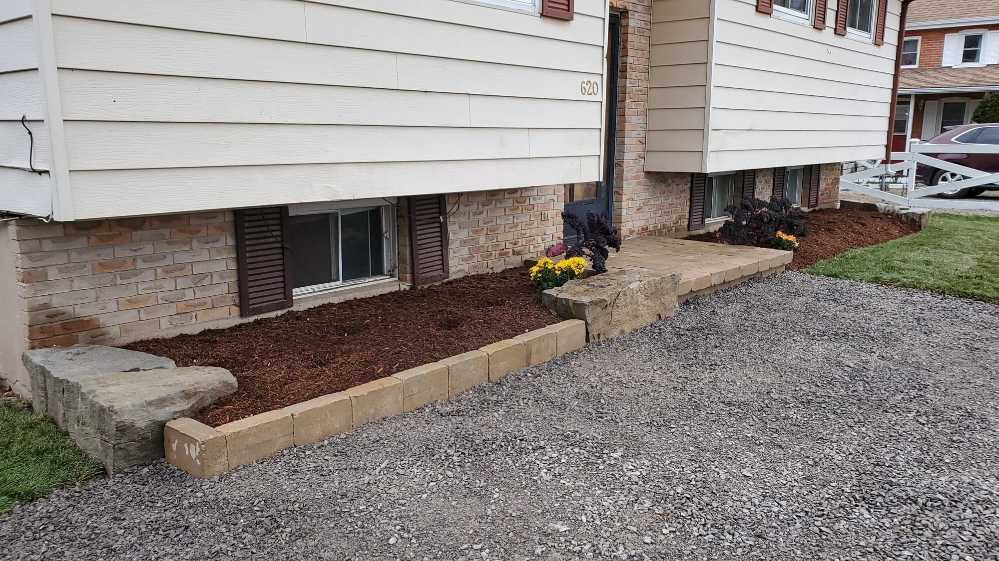 front of house with new garden beds